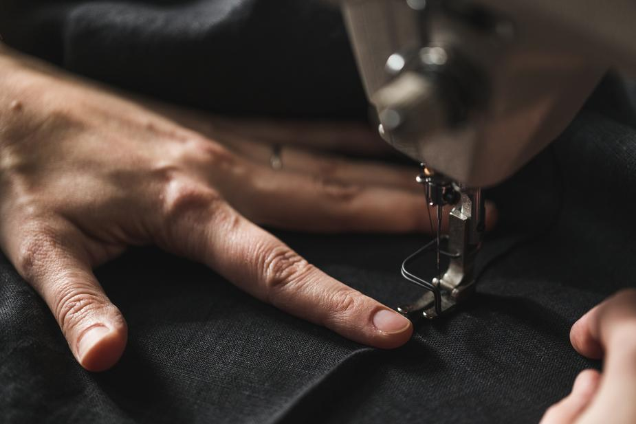Apparel production black fabric in sewing machine